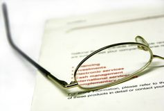 Banking #2. Glasses and banking book Royalty Free Stock Image