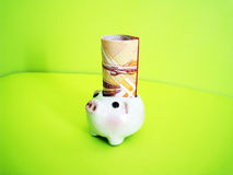 Banking. A piggy ornament with money, metaphors for banking, finance Stock Photos