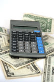 Banking. Pile of money with a calculator on top Stock Images