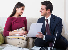 Banking agent with nice offer consulting customer at home Royalty Free Stock Photo