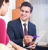 Banking agent with nice offer consulting customer at home Stock Images