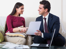 Banking agent with nice offer consulting customer at home Royalty Free Stock Photos