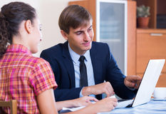 Banking agent with nice offer consulting customer Royalty Free Stock Images