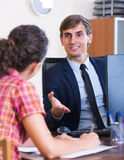 Banking agent with nice offer consulting customer Royalty Free Stock Photo