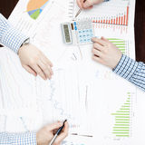Banking and all things related - 1 to 1 ratio. Two businessmen discussing some financial data at the desk - 1 to 1 ratio image Royalty Free Stock Photo