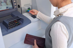 Banking. Asian woman banking at ATM with a bank card stock photos