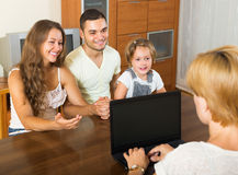 Banking assistant and satisfied family Royalty Free Stock Photo