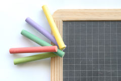 Banking and business concept. Colors chalks and chalkboard on white background Royalty Free Stock Photography