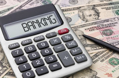 Banking. A calculator with money - Banking Stock Photo
