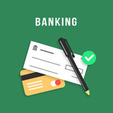 Banking with charge card and bank check Stock Photo