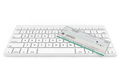 Banking Check over Computer Keyboard Stock Images