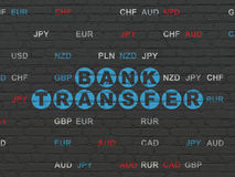 Banking concept: Bank Transfer on wall background. Banking concept: Painted blue text Bank Transfer on Black Brick wall background with Currency Stock Photography