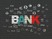 Banking concept: Bank on wall background. Banking concept: Painted multicolor text Bank on Black Brick wall background with  Hand Drawn Finance Icons Stock Photos