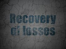 Banking concept: Recovery Of losses on grunge wall background. Banking concept: Blue Recovery Of losses on grunge textured concrete wall background Stock Image