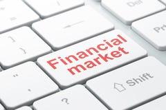 Banking concept: Financial Market on computer keyboard background. Banking concept: computer keyboard with word Financial Market, selected focus on enter button Stock Photos