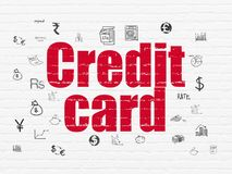 Banking concept: Credit Card on wall background. Banking concept: Painted red text Credit Card on White Brick wall background with  Hand Drawn Finance Icons Stock Photo