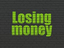 Banking concept: Losing Money on wall background Stock Photography