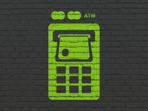 Banking concept: ATM Machine on wall background. Banking concept: Painted green ATM Machine icon on Black Brick wall background Royalty Free Stock Images