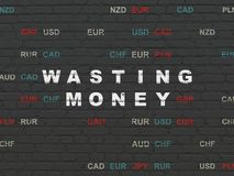 Banking concept: Wasting Money on wall background Stock Images