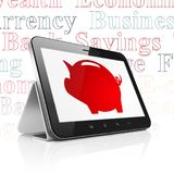 Banking concept: Tablet Computer with Money Box on display. Banking concept: Tablet Computer with  red Money Box icon on display,  Tag Cloud background, 3D Stock Photography
