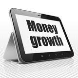 Banking concept: Tablet Computer with Money Growth on display Stock Photos