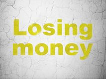 Banking concept: Losing Money on wall background. Banking concept: Yellow Losing Money on textured concrete wall background stock photography
