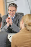 Banking consultant with clients stock photography