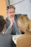 Banking consultant listening to clients royalty free stock photos