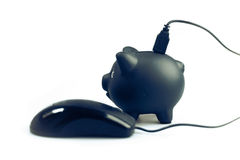 Banking on line and saving money idea with piggy bank and mouse. Stock Images