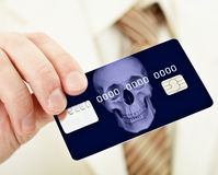 Banking plastic credit card bearing death Stock Photos