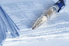 Banking report. S on a folded sheets and pen Royalty Free Stock Images