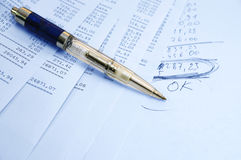 Banking report. Prints of financial report on a sheets and pen Royalty Free Stock Image