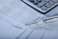 Banking report. Prints of financial report on sheets with pen and calculator Stock Photography
