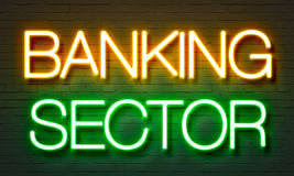 Banking sector neon sign on brick wall background. Banking sector neon sign on brick wall background Stock Photography