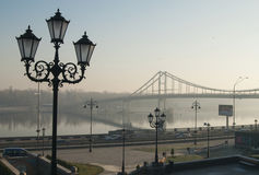Banking. A banking with a street lamp and a bridge over the river royalty free stock images
