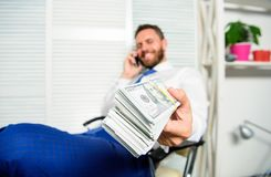 Banking support line concept. Man successful businessman phone conversation ask service. Businessman rich bearded guy. Sit office with lot of cash money. Bank royalty free stock photos