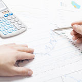 Banking, taxing and all things related with world of finance - 1 to 1 ratio. Businessman analyzing some financial data at the desk - 1 to 1 ratio Stock Image