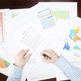 Banking, taxing and all things related with world of finance - 1 to 1 ratio. Businessman working with some financial data at the desk - 1 to 1 ratio Royalty Free Stock Photography