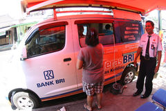 Banking transaction. Rural residents are conducting bank transactions in a mobile bank service car in Boyolali, Central Java, Indonesia Stock Photography