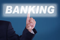 Banking. Young man pressing a button banking Stock Photos