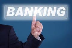 Banking. Young man pressing a button banking stock photos