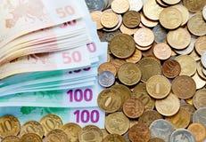 banknotów monet euro rozmaitość Zdjęcia Royalty Free