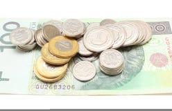 Banknot i monety na białym tle Obraz Stock