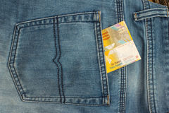Banknote in back pocket Royalty Free Stock Photography
