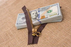 Banknote bundle of US dollar and brown zipper Royalty Free Stock Images