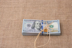 Banknote bundle of US dollar tied with a linen ribbon Stock Image