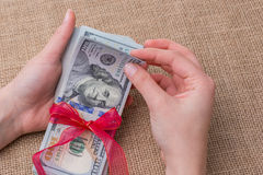 Banknote bundle of US dollar tied with a ribbon Stock Photos