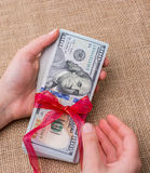 Banknote bundle of US dollar tied with a ribbon Stock Photography