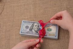 Banknote bundle of US dollar tied with a ribbon Royalty Free Stock Photos