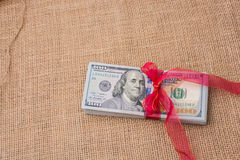 Banknote bundle of US dollar tied with a ribbon Royalty Free Stock Image